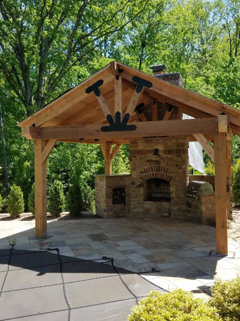 backyard pavilion with a fireplace