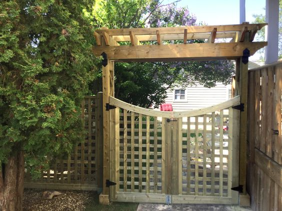 Arbors over gates create a beautiful entrance to a yard or garden.